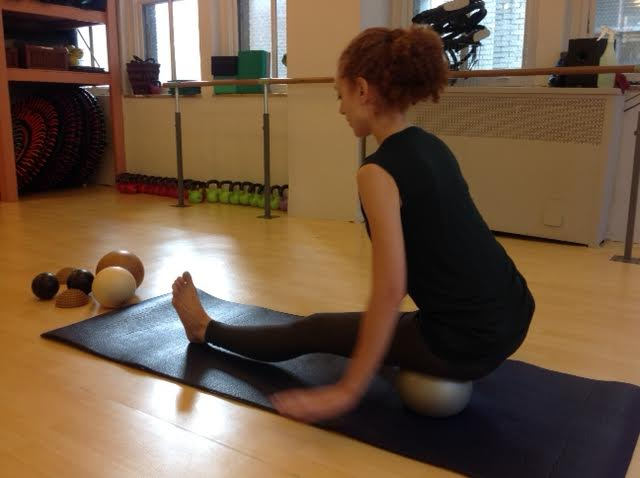 Yamuna Ball Rolling at Pilates on Fifth for Hamstring Release